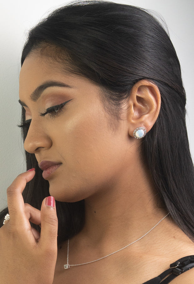 Fashion model wearing sterling Silver fashion statement stud opal earrings