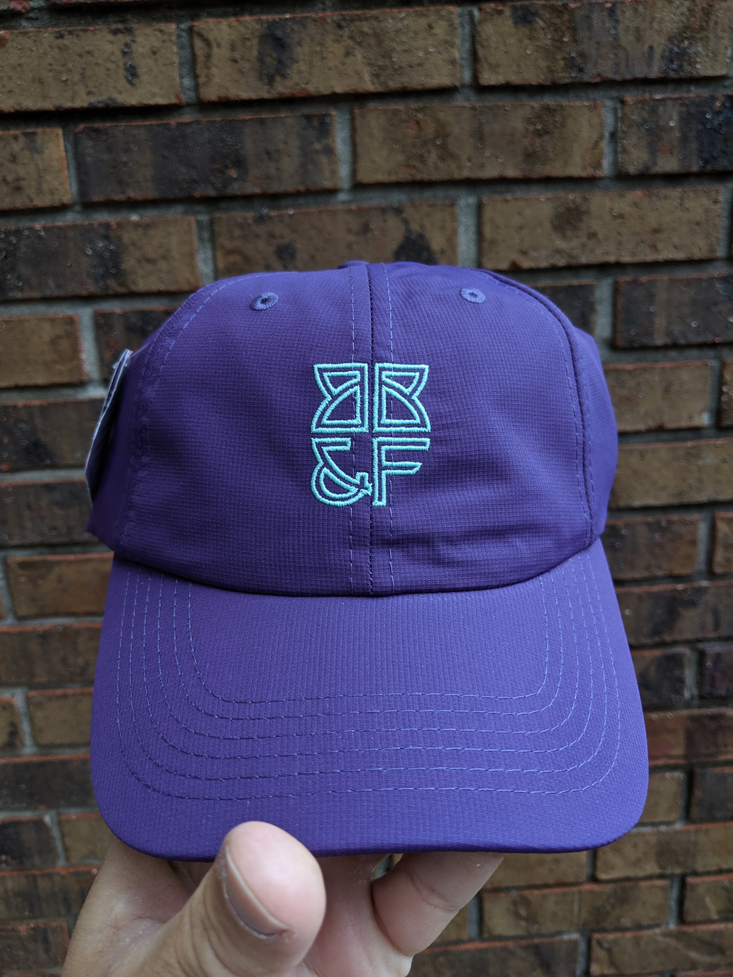 GDP (Purple hat with mint green logo)