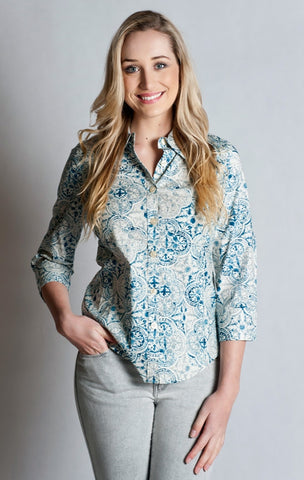 97% Cotton / 3% Spandex, Printed  Blue Shirt- 3/4 sleeve, fitted at back.
