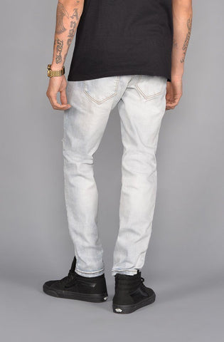 Image of Seena Rip and Repair Tapered Jeans (Light Indigo)
