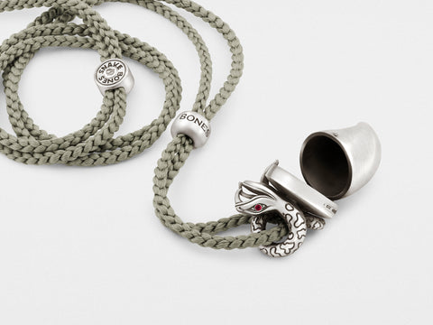 Snake Pendant Necklace with Tusk Locket and Ruby Eyes