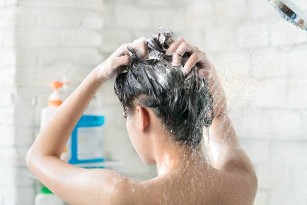 woman showering with good shampoo lather