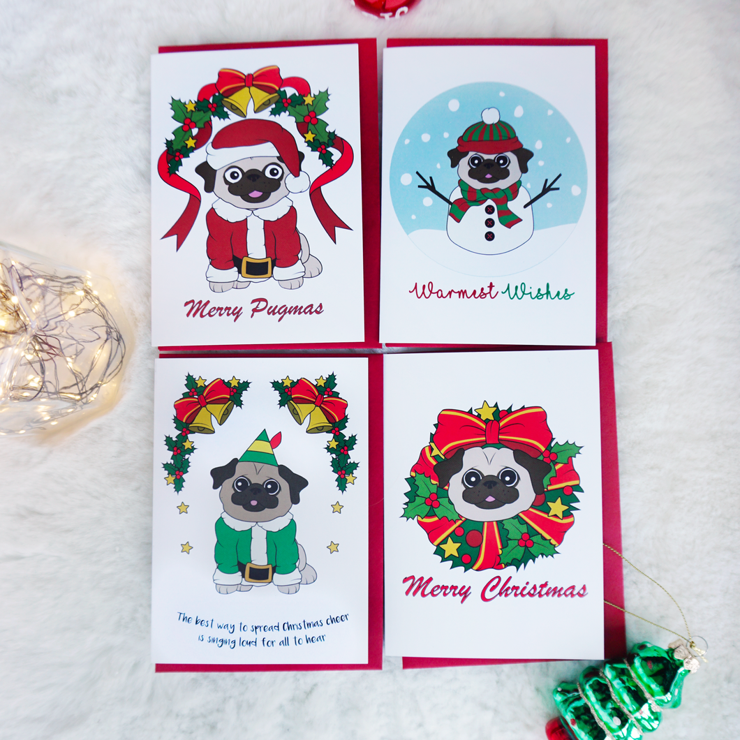 four christmas cards with pugs