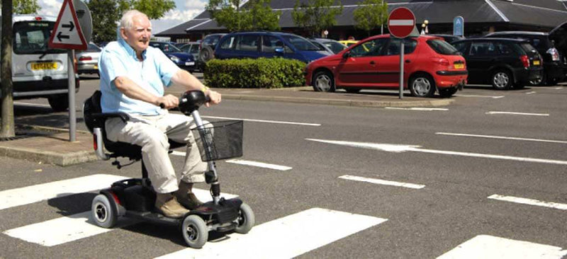 Mobility Scooter Rules Nsw Man On Scooter On Pedestrian Crossing