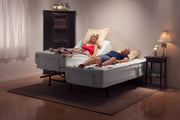 Adjustable Electric Beds Low Lit Room With Two People Laying On Two Separate Beds