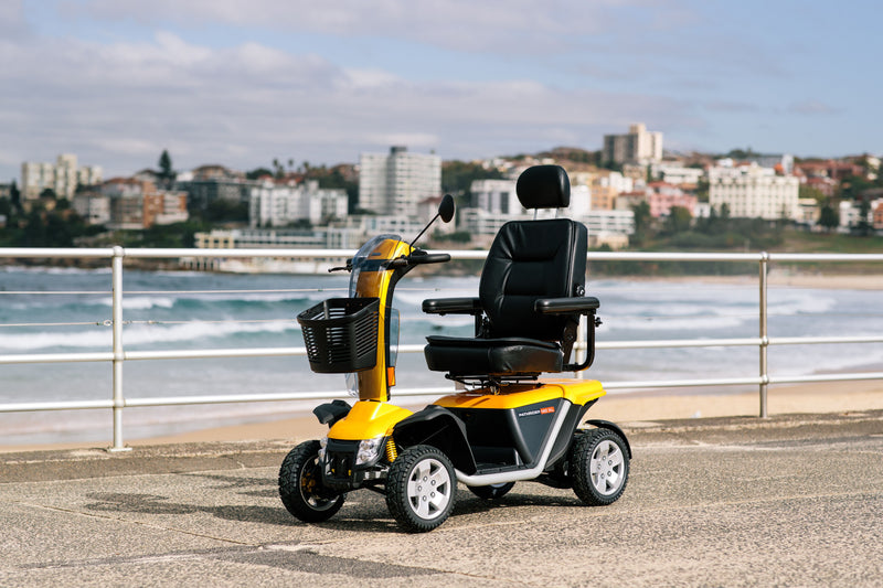 Pride Mobility Australia Black Gold Scooter placed outside