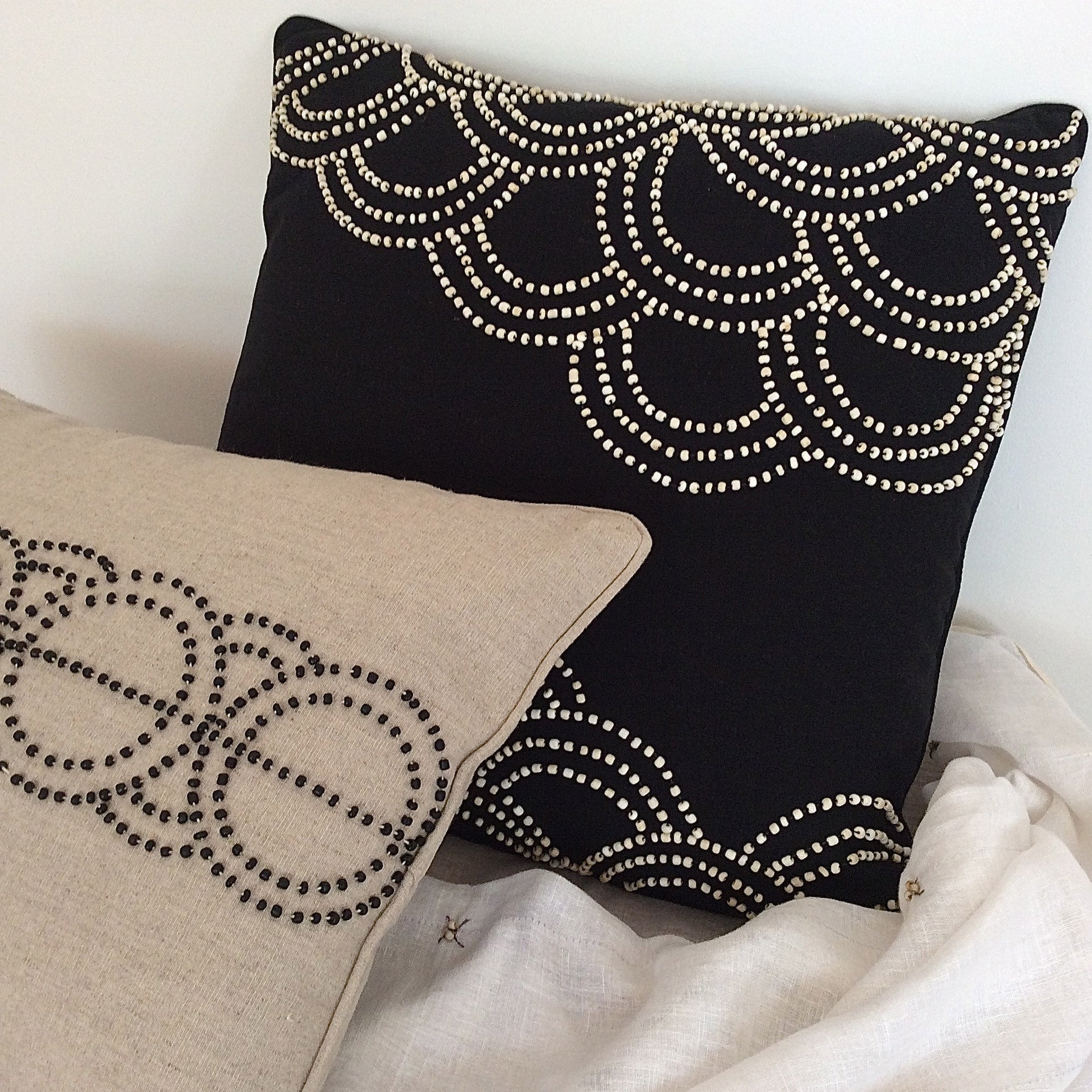 'tide natural on black' cushion