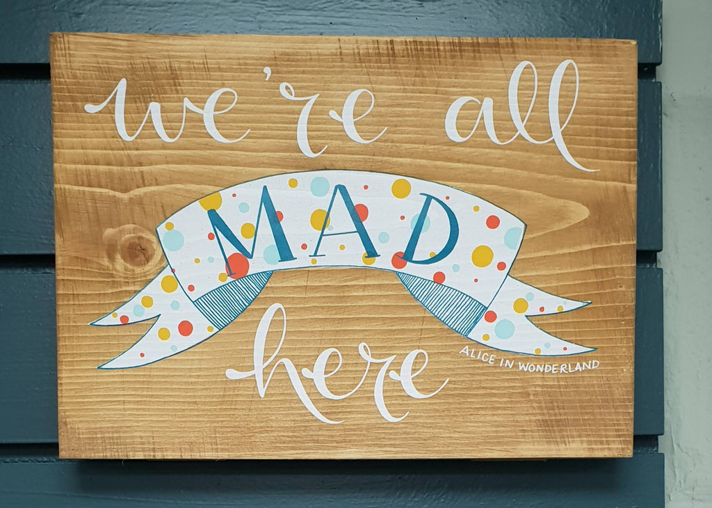 We are all mad here wooden sign