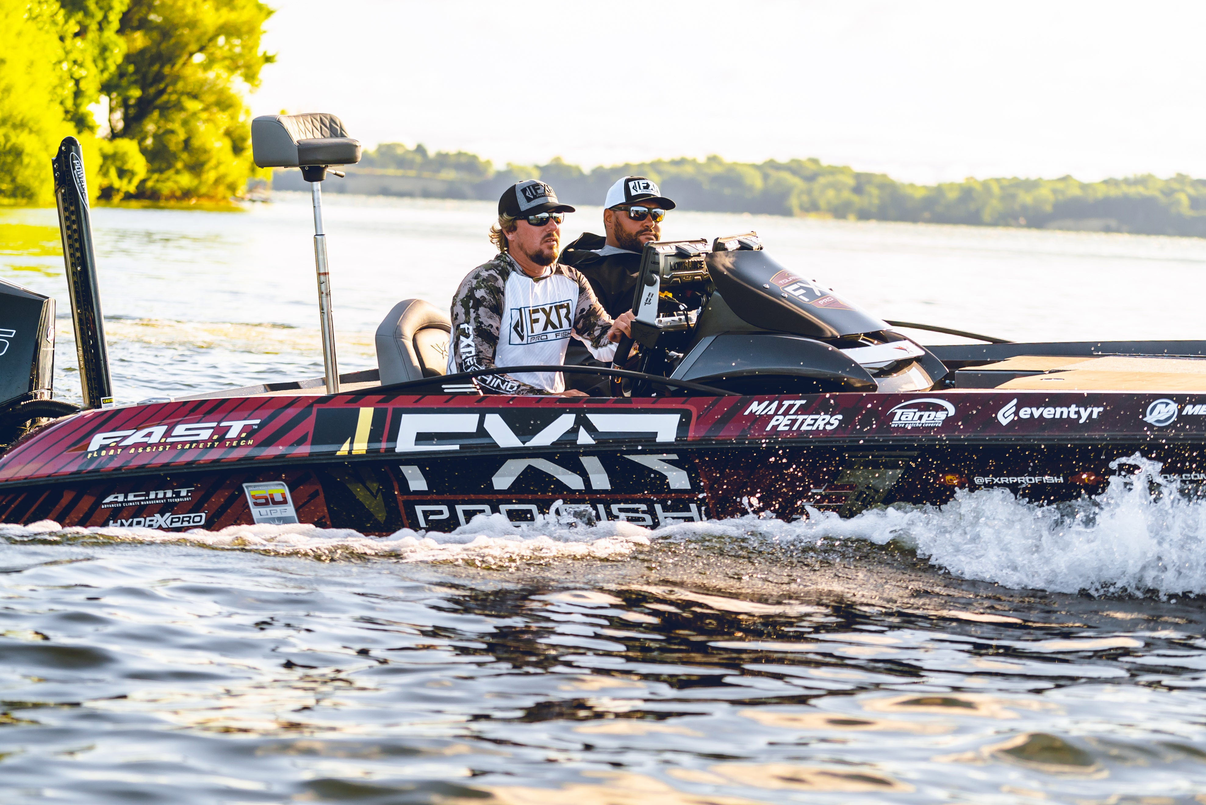 Image of tournament anglers Matt Peters and Dustin Byfuglien on the water in their custom wrapped Pro Fish Vexus bass boat on a beautiful sunny day.