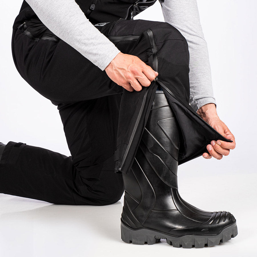 A bigger image demonstrating the full length 2-way YKK Waterproof side leg zippers feature on FXR's Vapor Pro Insulated Bib Pant.