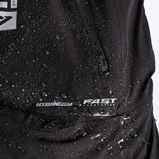 A smaller close-up image of FXR's Vapor Insulated Bib Pant with water droplets on top and FXR's F.A.S.T™ Float Assist Safety Technology logo.