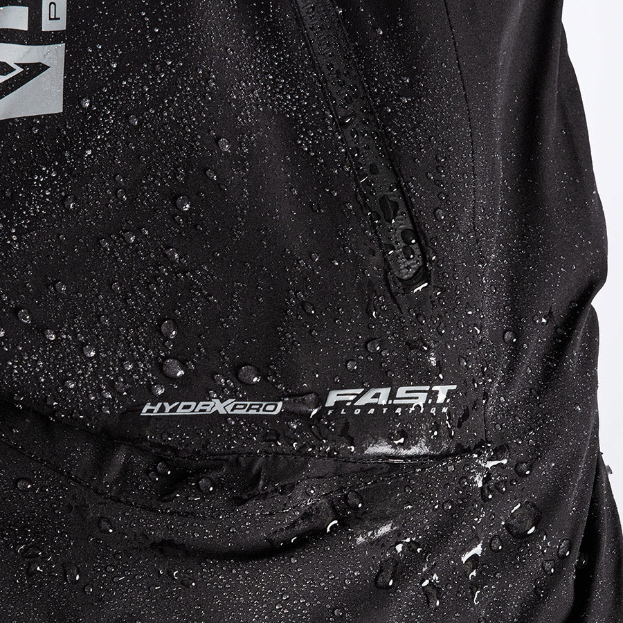A bigger close-up image of FXR's Vapor Insulated Bib Pant with water droplets on top and FXR's F.A.S.T™ Float Assist Safety Technology logo