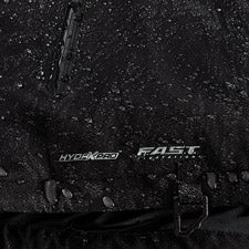 A smaller close-up shot of FXR's Vapor Insulated Jacket with water droplets on top and FXR's F.A.S.T™ Float Assist Safety Technology logo.