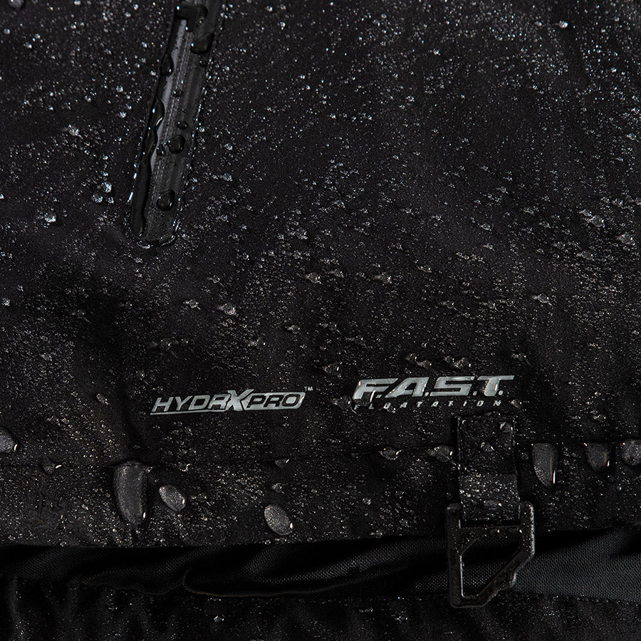 A bigger close-up shot of FXR's Vapor Insulated Jacket with water droplets on top and FXR's F.A.S.T™ Float Assist Safety Technology logo.