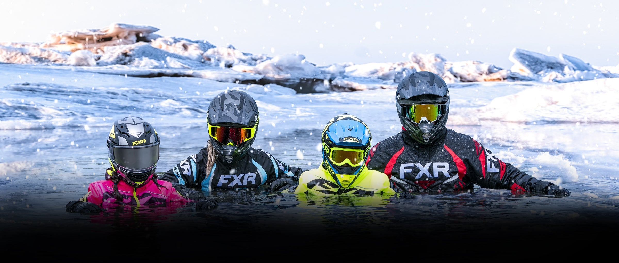 An image of family of four wearing snow jackets with FXR's F.A.S.T Technology