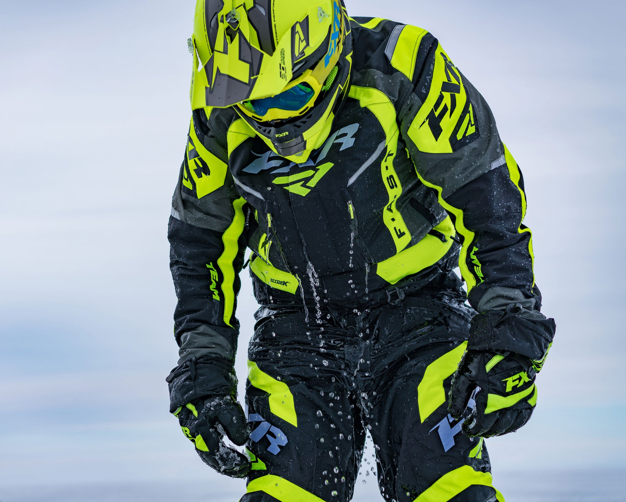 An image of a guy in FXR's F.A.S.T suit demonstrating the wet/dry insulation feature
