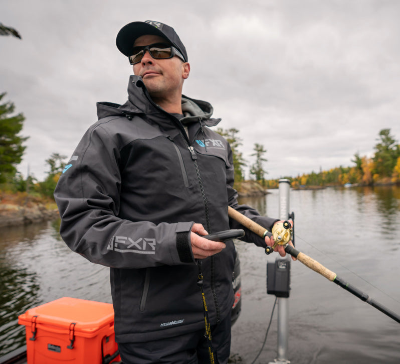 Picture of a guy out fishing in his FXR's men's charcoal black Vapor Pro Insulated Jacket with F.A.S.T. Float Assist Safety Technology