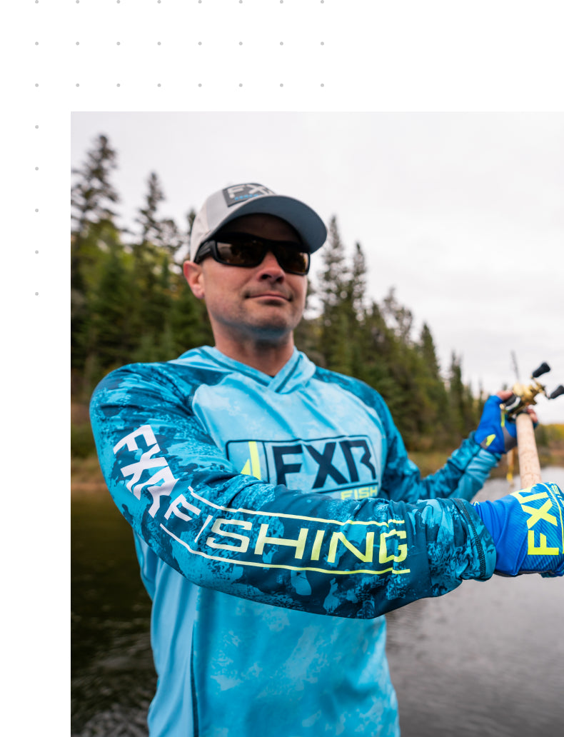 Image of a man sporting the new Tournament Pro Hybrid UPF pullover hoodie in slate and blue camo colorway.