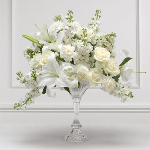 Classic white arrangement in the glass vase