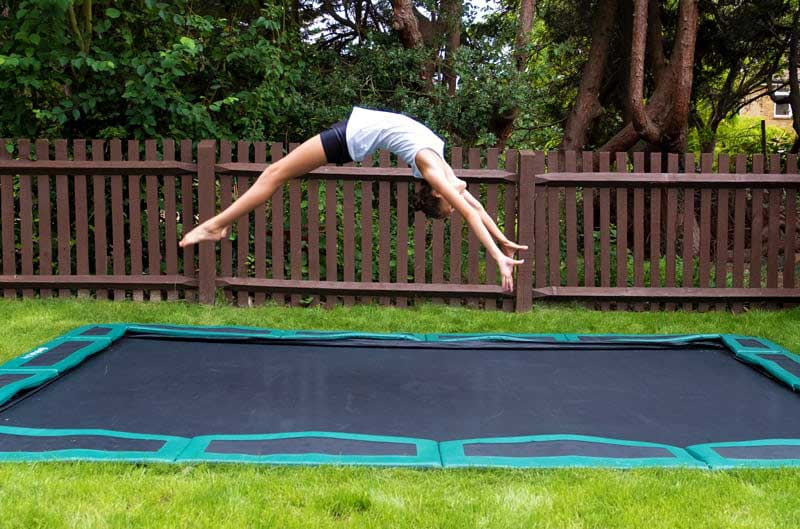 gymnast on in-ground trampoline