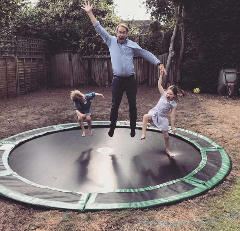 dad on trampoline with kids