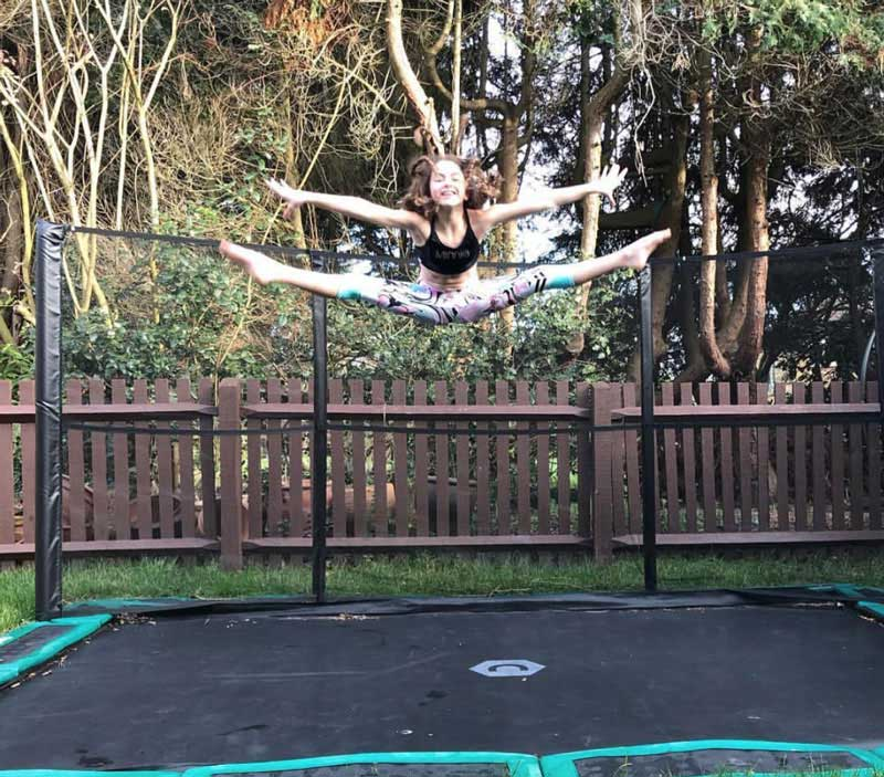Gymnast on trampoline in ground