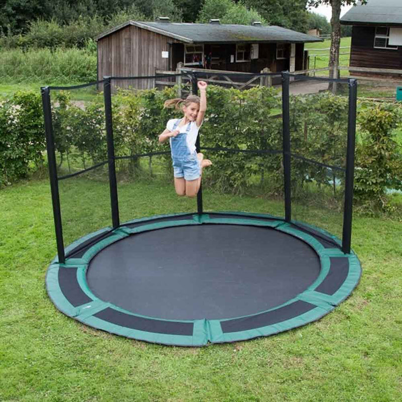 10ft in-ground trampoline with half safety net in backyard