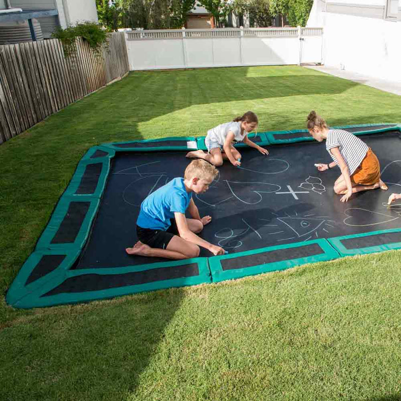 kids playing on sunken trampoline