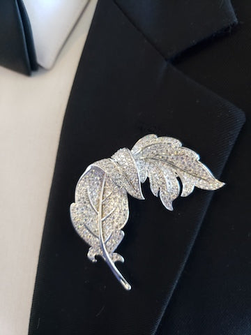 silver lapel pin and silver broche