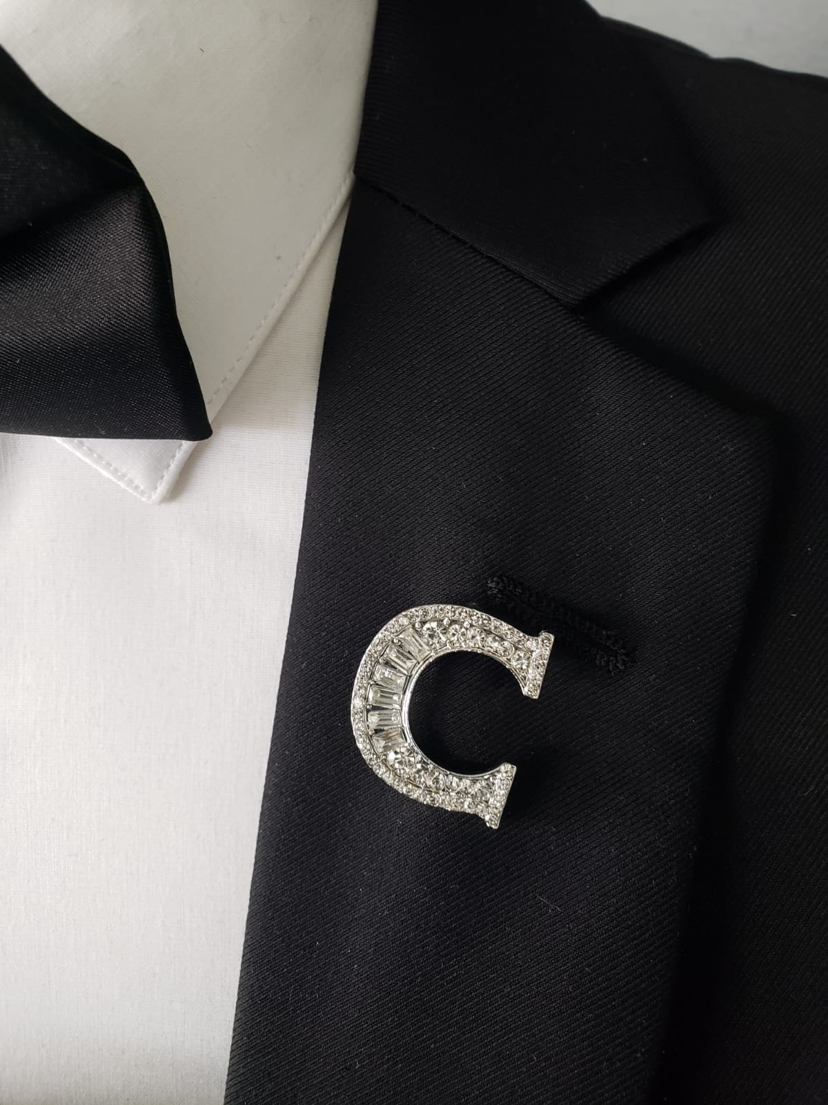 "Blinged out ""C"" lapel pin"