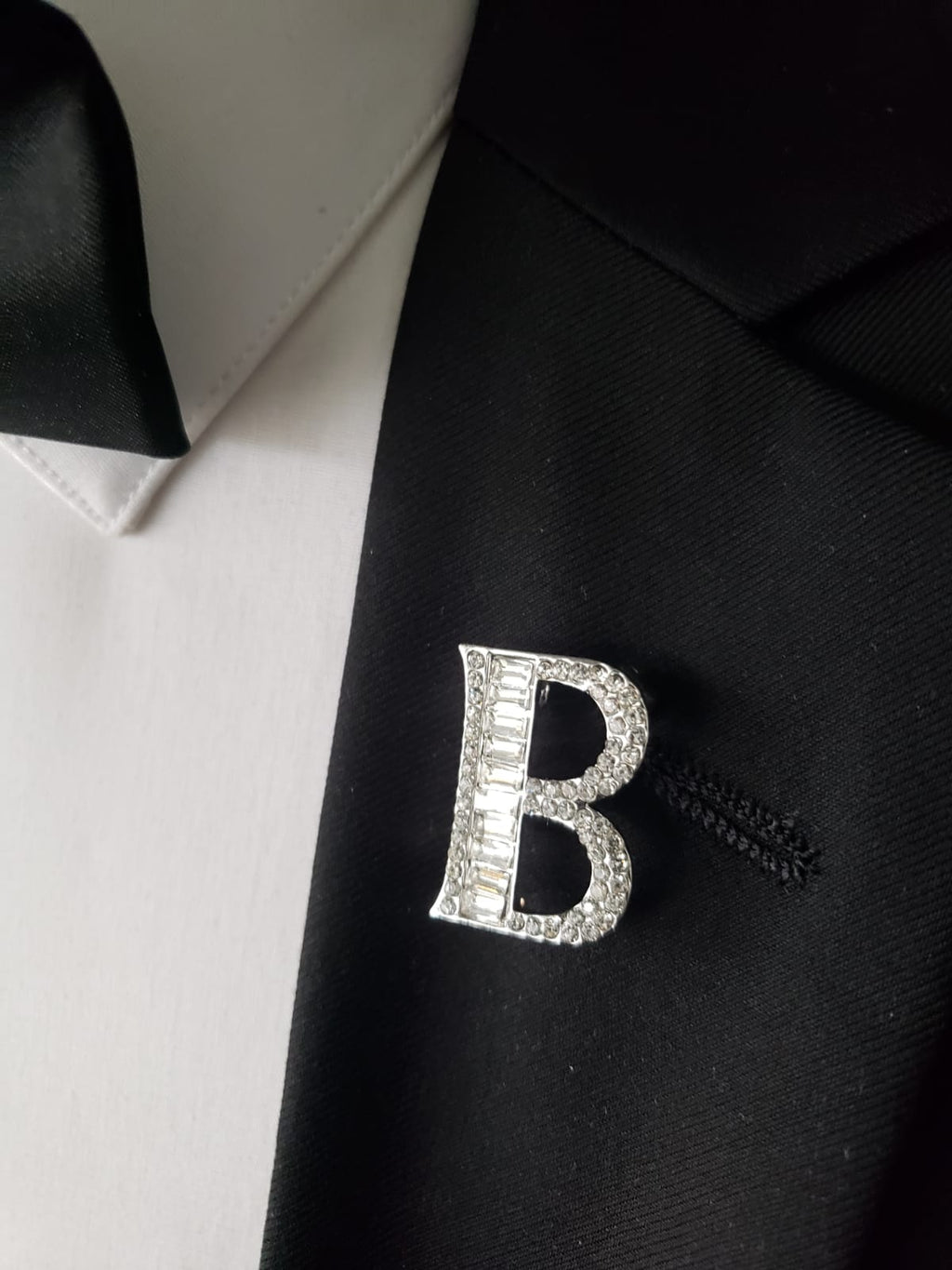"Blinged out ""B"" lapel pin"