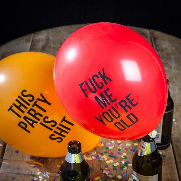 abusive party balloons on a table