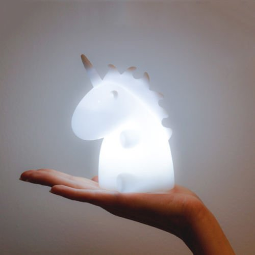 unicorn night light by smoko in White and on a hand