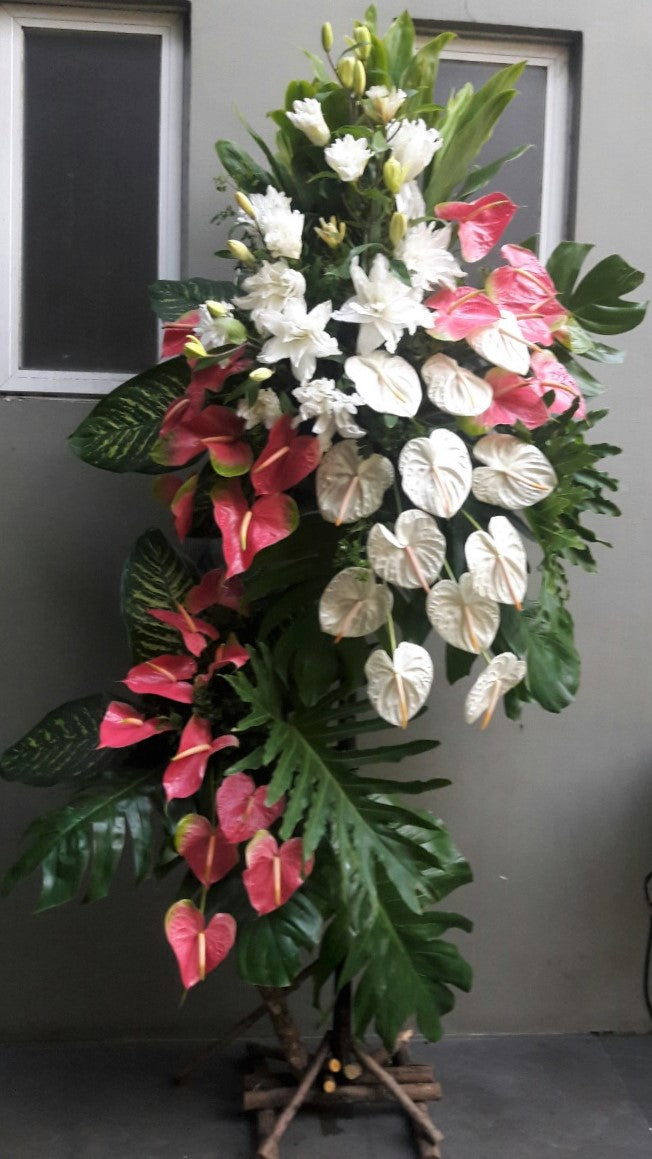 standing arrangement with anthuriums and lilies