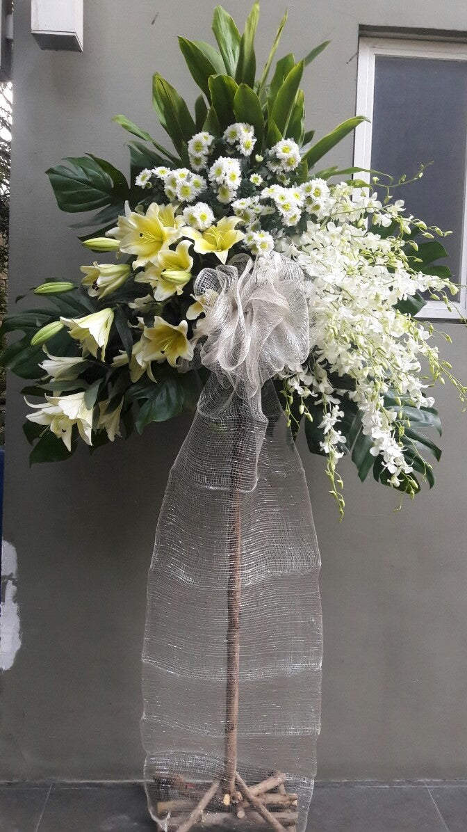standing arrangement with orchids, lilies, and chrysanthemums