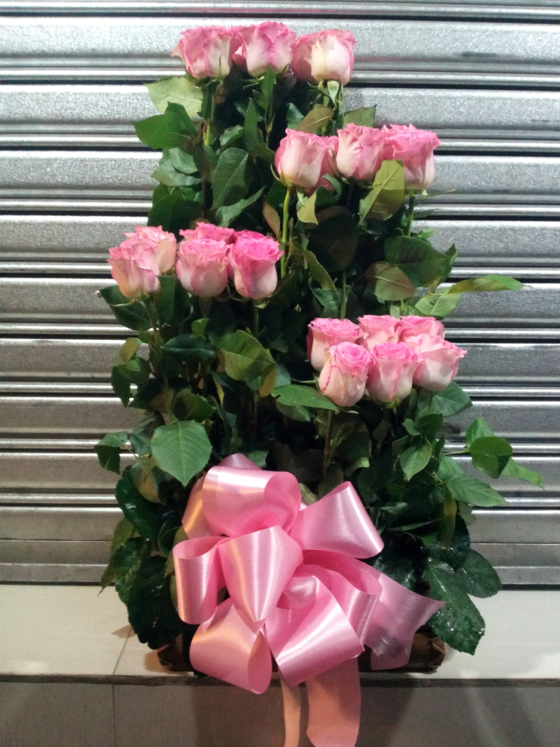 Half faced arrangement with pink holland roses