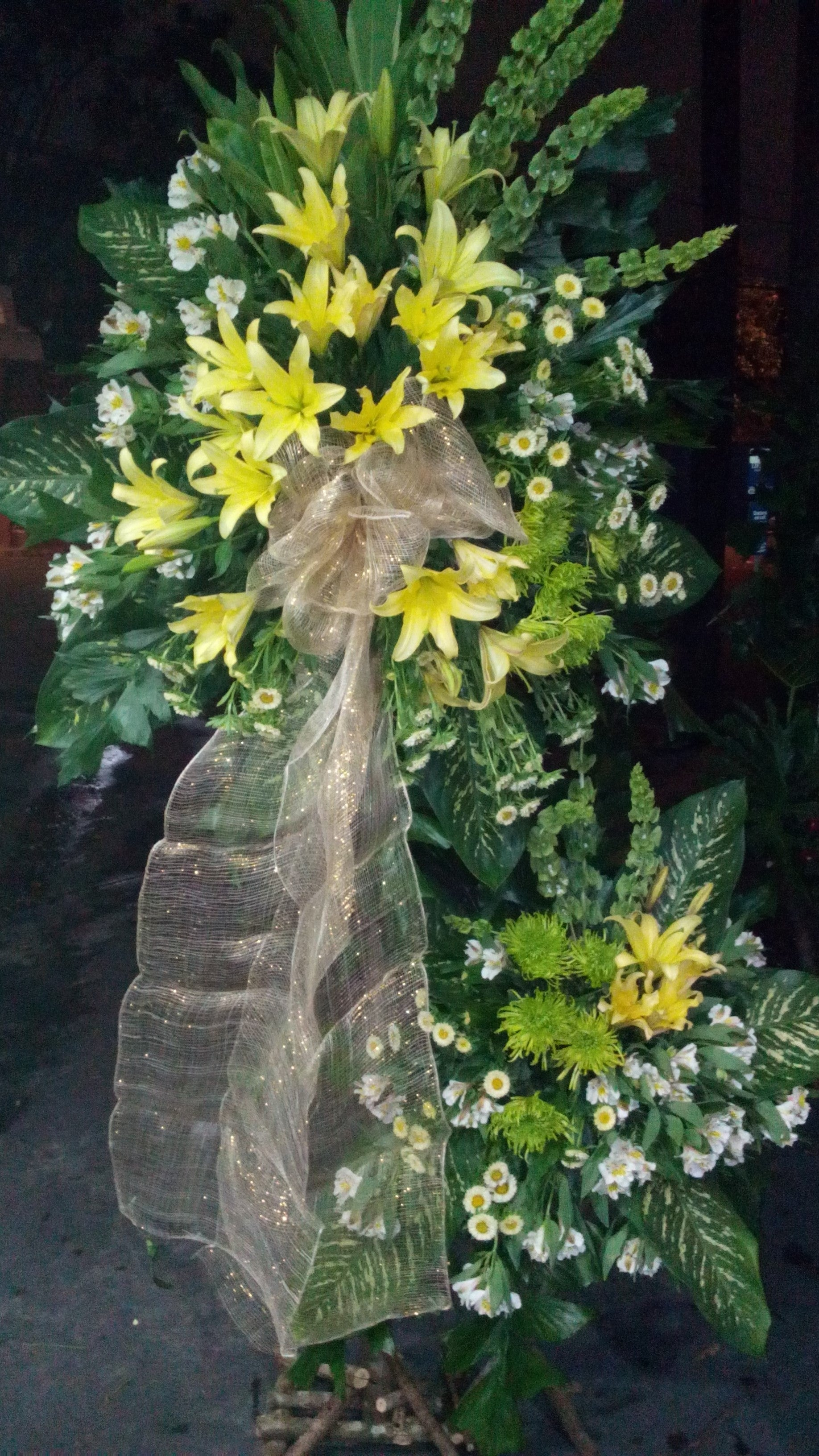 standing arrangement with lilies and chrysanthemums