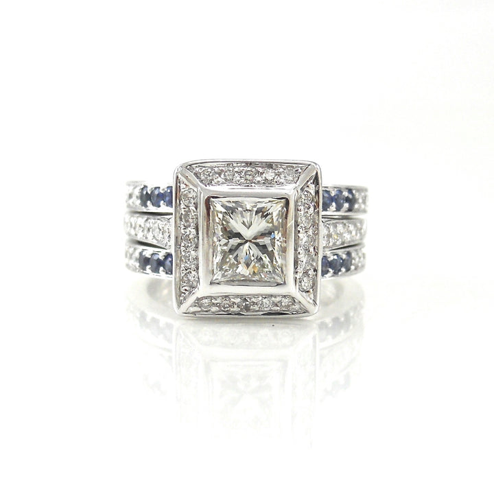 bezel-set princess cut diamond engagement ring with sapphire accents