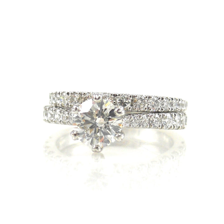 diamond solitaire engagement ring with diamond accents and matching diamond wedding band