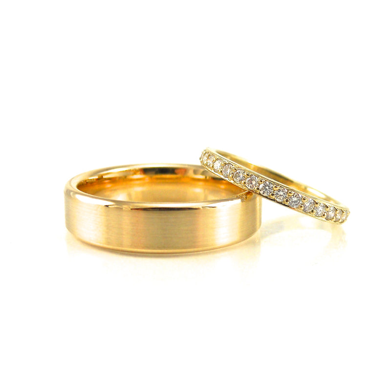 yellow gold wedding band for groom and matching yellow gold and diamond wedding band for her