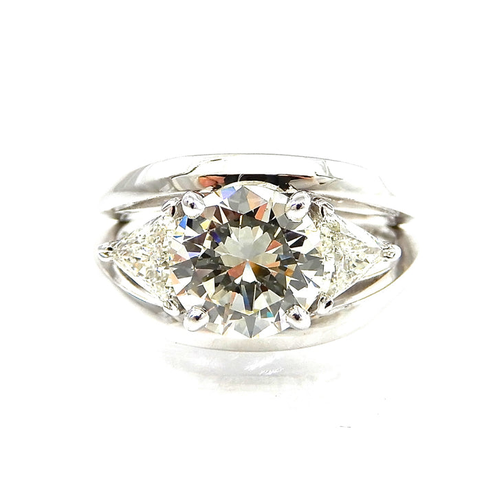 Custom ring round brilliant cut diamond center stone with trillion cut diamond accents