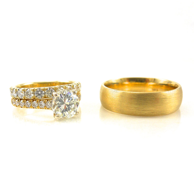 solitaire engagement ring and yellow gold wedding band set