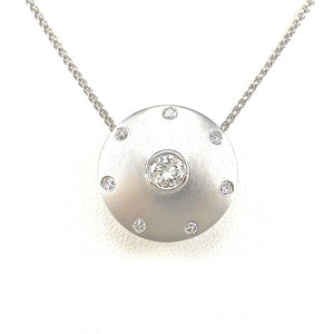 bezel-set round brilliant cut diamond center stone with diamond accents in satin finished white-gold necklace