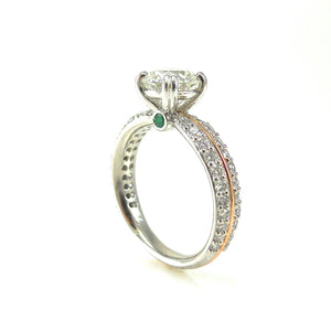Diamond Engagement Ring with Emerald Accents