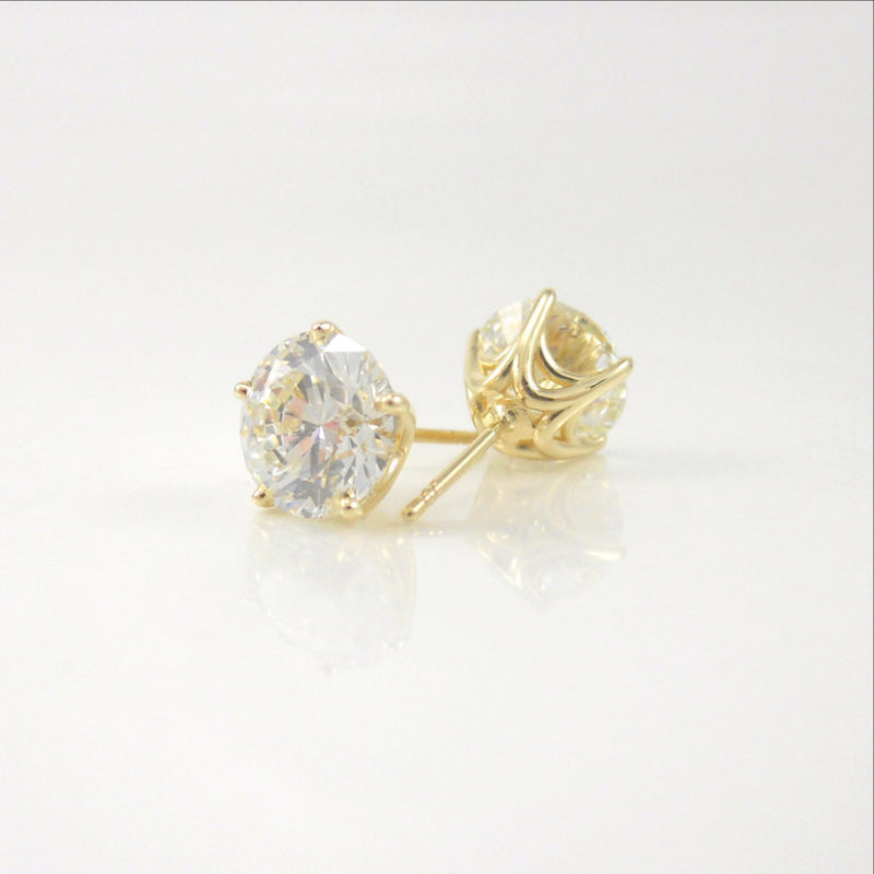 4.02ct diamond studs featured in custom-designed 14k yellow-gold baskets