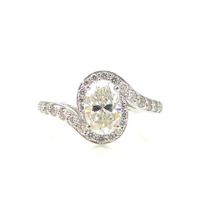 custom engagement ring prong-set center stone and diamond accented bypass-style shank