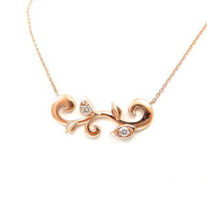 organic rose-gold, diamond accented station necklace