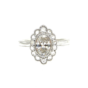 custom scalloped diamond halo with milgrain detailing engagement ring