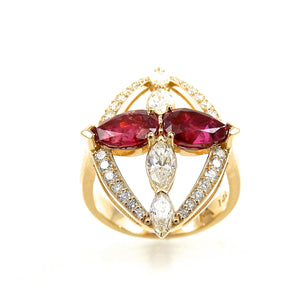 Yellow Gold pear cut rubies and marquise diamond ring