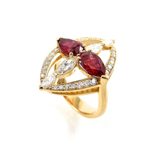 pear cut rubies and marquise diamonds with a round brilliant cut diamond accented frame